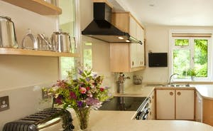 Bespoke designer kitchen with corian work surfaces and maple units