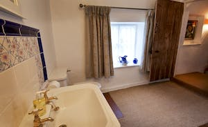 Halse Water House - Traditional interiors in the shared shower room on the ground floor