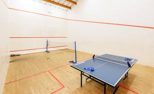 Full size traditional championship squash court with table tennis / badminton