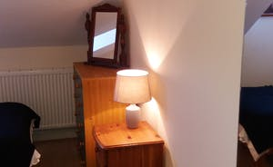 Bedroom 3 with 2 single beds & built in cupboards