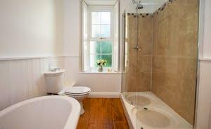 Sandfield House - The main bathroom has a roll top bath and a big shower