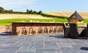 The Granary - That outside space is incredible! A huge sociable cooking area, plenty of seating, heaps of room for the kids, and that wonderful BBQ hut!