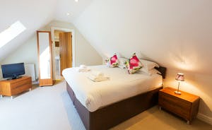 Cockercombe - Bedroom 6 is on the first floor and has an en suite bathroom