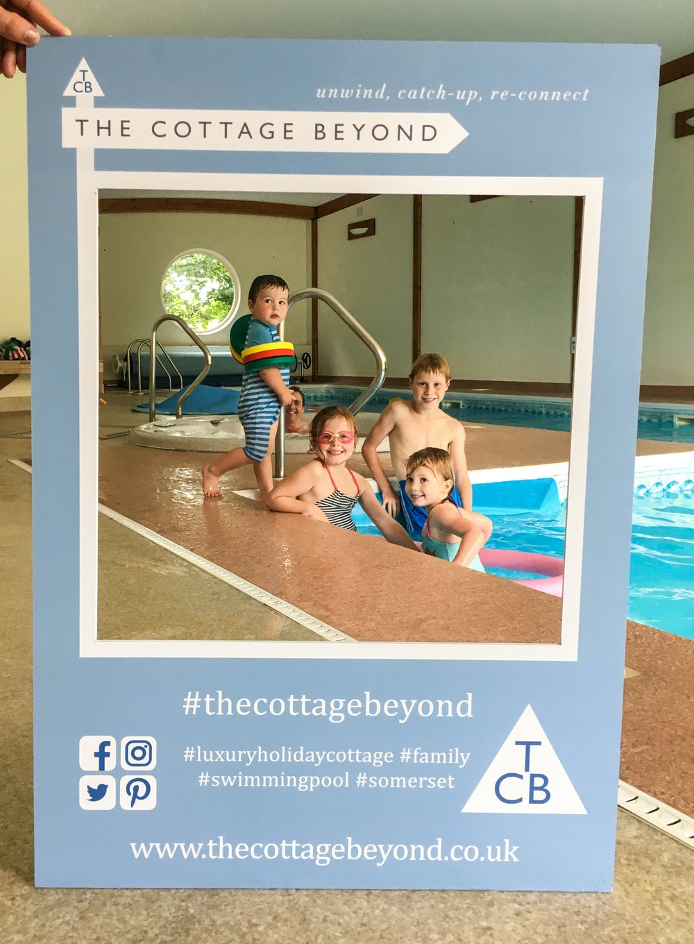 TCB's selfie board in the swimming pool