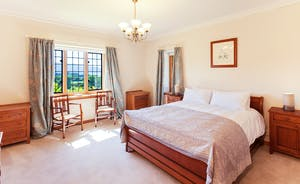 Bossington Hall - Danes Brook; a bedroom with divine views and period furniture