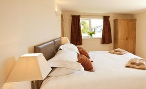 Holemoor Stables - Bedroom 5 can have a super king or twin beds; it has an en suite shower room