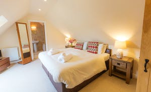 Thorncombe - Bedroom 5 is on the first floor with a lovely en suite bathroom