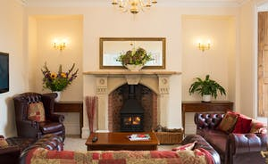 The Old Rectory - A light and airy sitting room with a beautiful fireplace as a focal point
