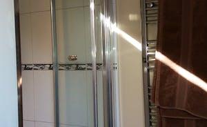En-suite to bedroom 2 power shower, toilet and basin