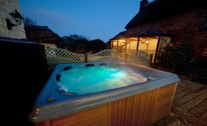 Halse Water House - Spend time outdoors in the private courtyard with a hot tub and lovely outdoor eating pavilion